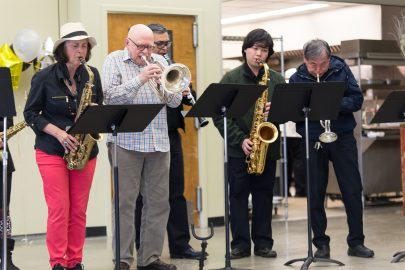 """From left to right, Frank Phipps, Van Mares, Ferdinand Hartanto, John Lou and the band performs """"When the Saints Go Marching In"""" by Katharine Purvis and James Milton Black as the opening song in the Pierre Coste Room on Apr. 13, 2017. Photo by John Ortilla/The Guardsman."""