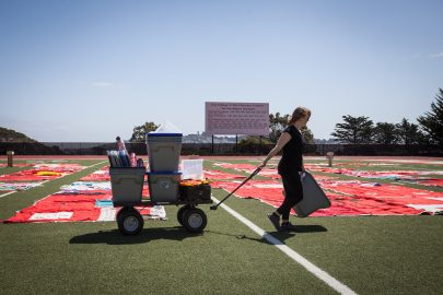 Co-Founder of FORCE: Upsetting Rape Culture Hannah Brancato helps set up during the installation of The Monument Quilt on the football field of George M. Rush Stadium at City College of San Francisco Ocean Campus on Saturday, May 6, 2017.  (Photo by Ekevara Kitpowsong)