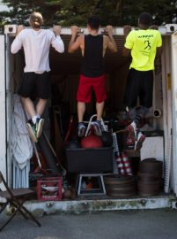 Rams track athletes Ronan Sullivan, Anthony Ismail and Rodney Morgan (left to right) do pull-ups using the edge of an equipment shed in the corner of the track field on May 1, 2017. (Nancy Chan / The Guardsman)