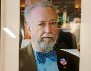 A photo of Ray Berard was featured at the John Adams Auditorium in a frame while they had his eulogy on Sept. 15, 2017. Photo by Barbara Muniz.