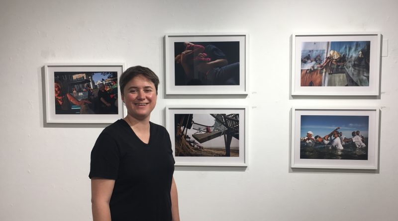 Pulitzer Prize-winner Preston Gannaway stands in front of her exhibition held on City College's Ocean Campus on September 6, 2017. (Photo by Laurie Maemura)