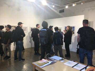 CCSF professor Judith Lynn Walgren discusses the meaning of aperture to CCSF photography and watercolor students at Preston Gannaway's exhibition on September 6, 2017. (Photo by Laurie Maemura)