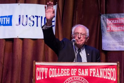 Senator Bernie Sanders waves at the cheering crowd after completing his speech at City College's Diego Rivera Theater on Sept. 22, 2017. (Photo by Jordi Molina/The Guardsman)
