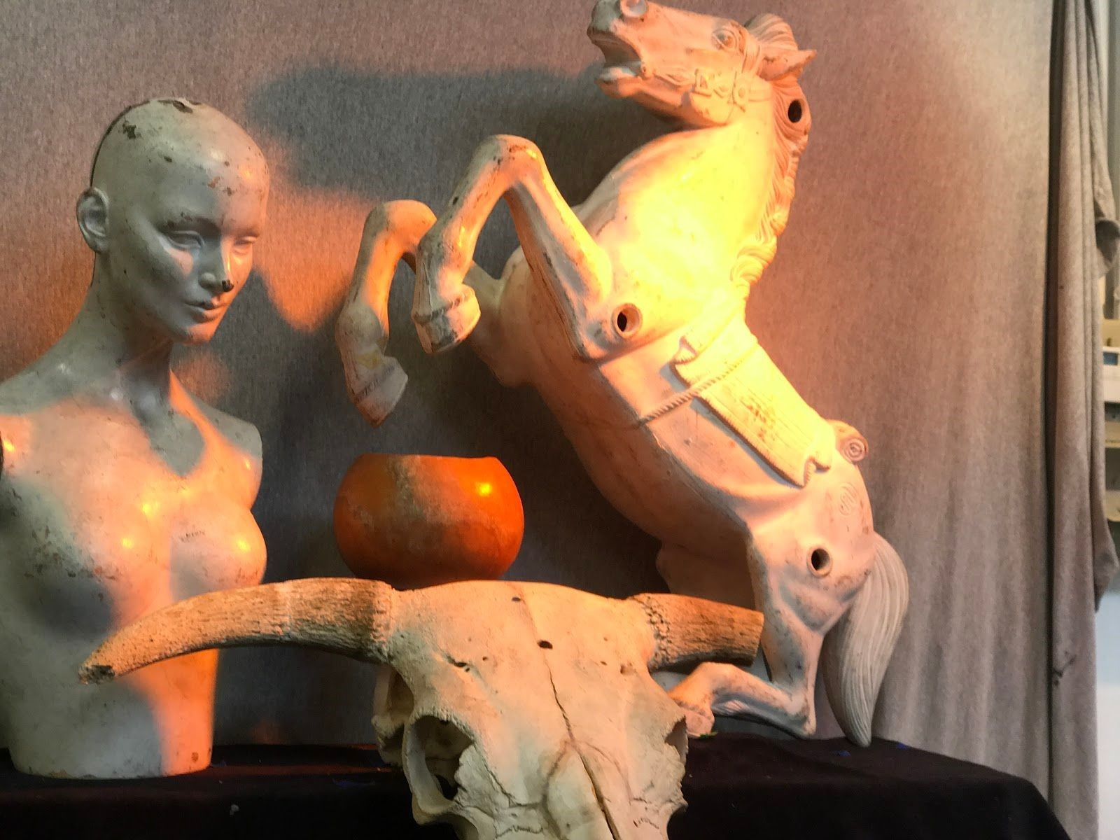 These figures were used for beginning art students to paint. An orange light is positioned overhead to give off a sunset vibe. Photo taken on Sep. ?, 2017 by Jasmine.