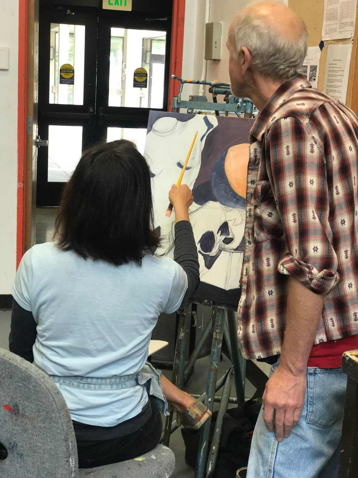 The instructor, Andrew Leone, is guiding a student and helping her pick the best colors to use. Photo taken on Sep. ?, 2017 by Jasmine