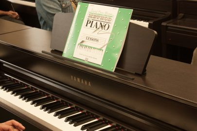Students prepare for their first day of piano class with new Yamaha pianos.  They test out the keys as they wait for the professor to arrive. August 23, 2017, in San Francisco, CA. (AP Photo/ Julia Fuller)