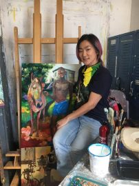 """Tsungwei Moo poses next to her painting """"Home Sweet Home"""" featuring her late boyfriend Ricardo Distin on October 2, 2017. Photo by Laurie Maemura."""