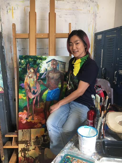 "Tsungwei Moo poses next to her painting ""Home Sweet Home"" featuring her late boyfriend Ricardo Distin on October 2, 2017. Photo by Laurie Maemura."