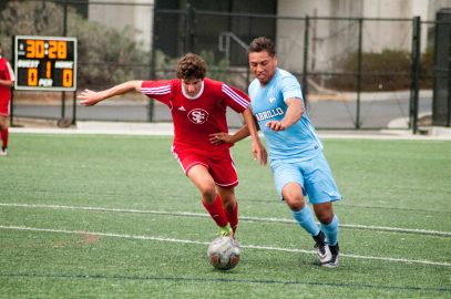 Freshman defense player Austin Rameriz  (L) fights for control of the ball during the make up game against Cabrillo College on October 17, 2017 at the Ocean Campus soccer field. Photo by Franchon Smith. Special to The Guardsman.