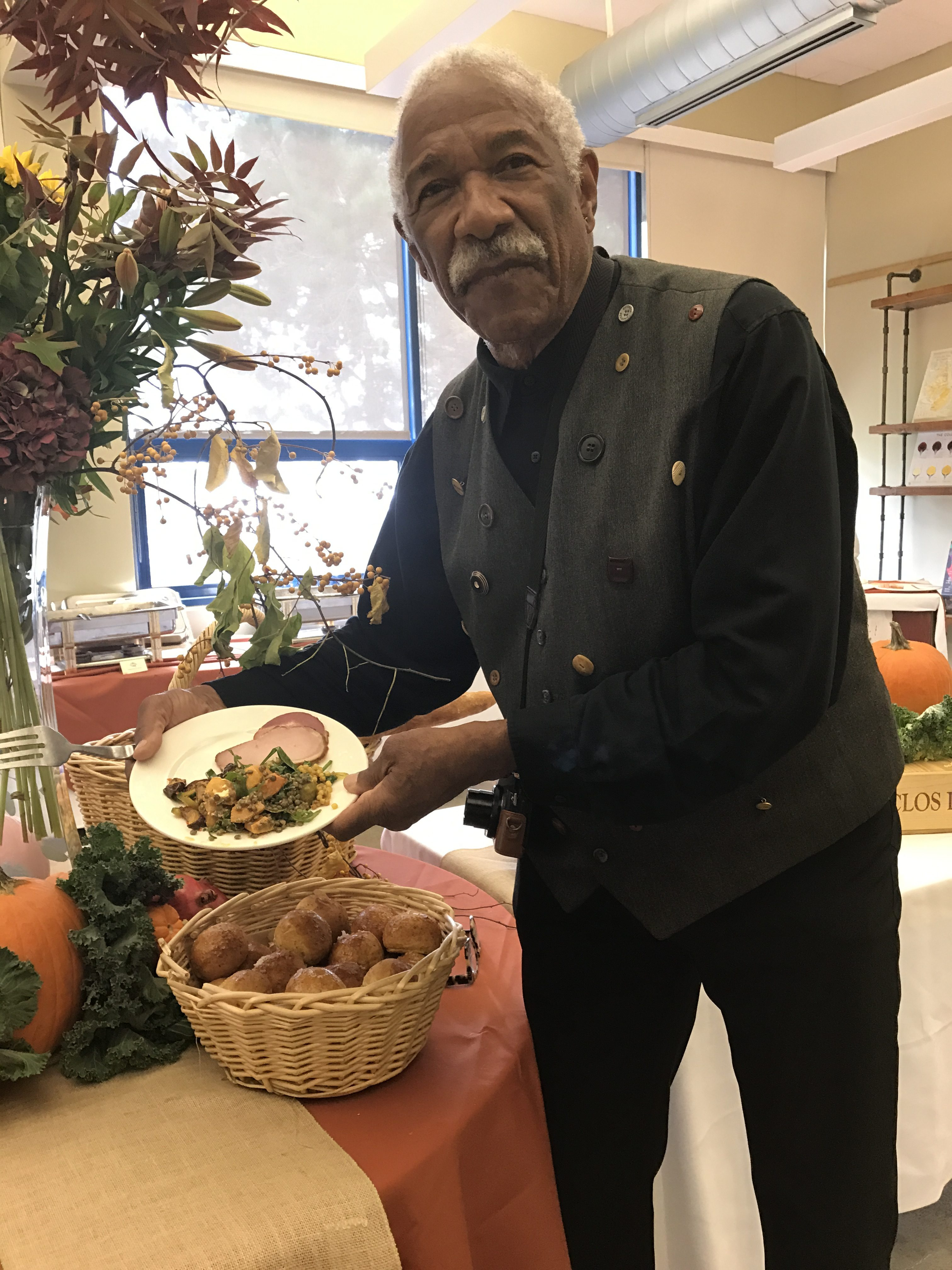 A Fall Harvest Festival attendee enjoys a plate of Autumn food on Wednesday, Oct. 18, 2017. Photo by Diane Carter.