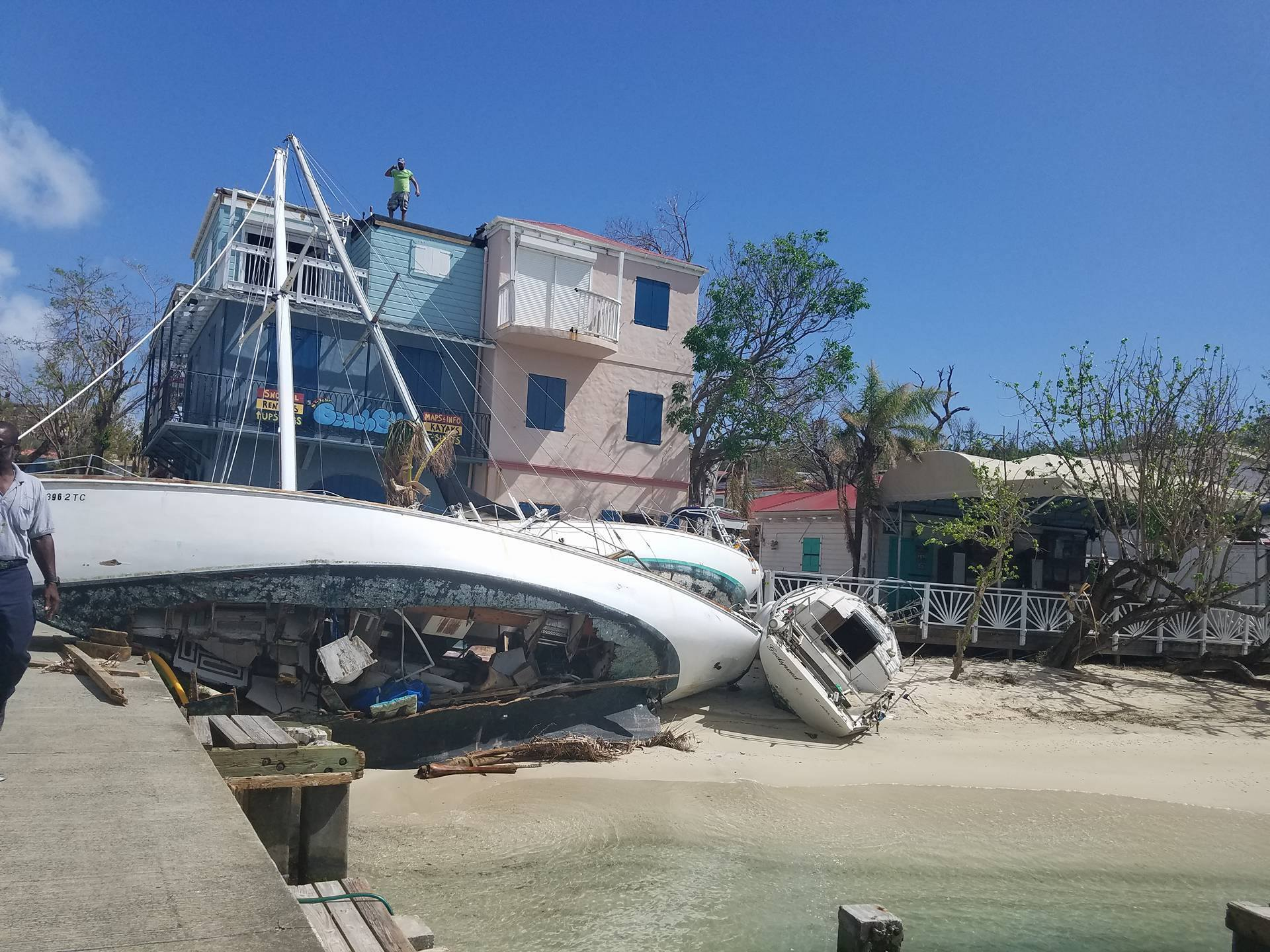 "Wreckage of dock with the ship ""The Vagrant"" run aground. Photo taken by Emma Graham-Winkles in the United States Virgin Islands Oct. 2017."