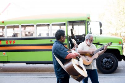 Miguel Govea and Johny Escobedo performing by the Mexican Bus near the home of Juan Fuentes. Photo taken Sept, 23, 2017 by Otto Pippenger.