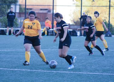 Arantxa Gomez Preito (#20) takes a midfield kick in the second half of the quarter, October 6,  Tyesha Sams-Sims (#2) of Chabot College attempts to block her pass. San Francisco. (AP Photo/ Julia Fuller)
