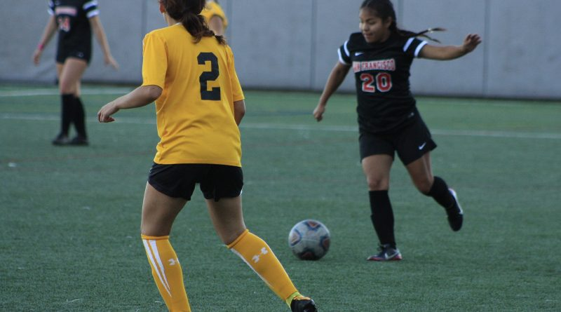 Angelica Gonzalez (#11) of City College goes in for a striking kick against Chabot's player Isabella Cruz (#22) who attempts to steal the ball from Gonzalez. October 6, San Francisco, (AP Photo/ Julia Fuller)