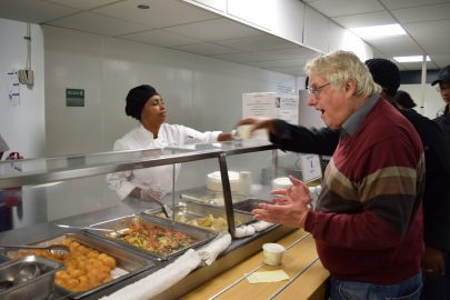 Laney college journalism instructor Scott Strains seems happy to see potato croquette as part of the manu that Laney College main cafeteria serves on Nov. 29, 2017. (Photo by Barbara Muniz)