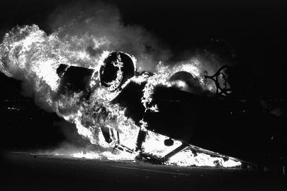 A LAPD car is overturn and set ablaze near the LAPD headquarters, in downtown Los Angeles. Los Angeles has undergone several days of rioting due to the acquittal of the LAPD officers who beat Rodney King. Hundreds of businesses were burned to the ground and over 55 people have been killed. (Photo by Ted Soqui/Corbis via Getty Images)