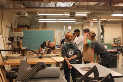 Raymond Cash leads the class in instruction before students disburse throughout the woodshop to work on their individual projects. Photo taken by Bethaney Lee on Nov. 6, 2017.