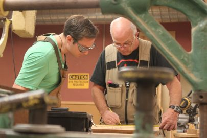 Pursuing carpentry as a passion, Cem Turhal is working with his teacher, Raymond Cash, to measure and mark a piece of pine wood for his project. Cash has over 30 years of experience that he offers to City College students. Photo taken by Bethaney Lee on Nov. 6, 2017.