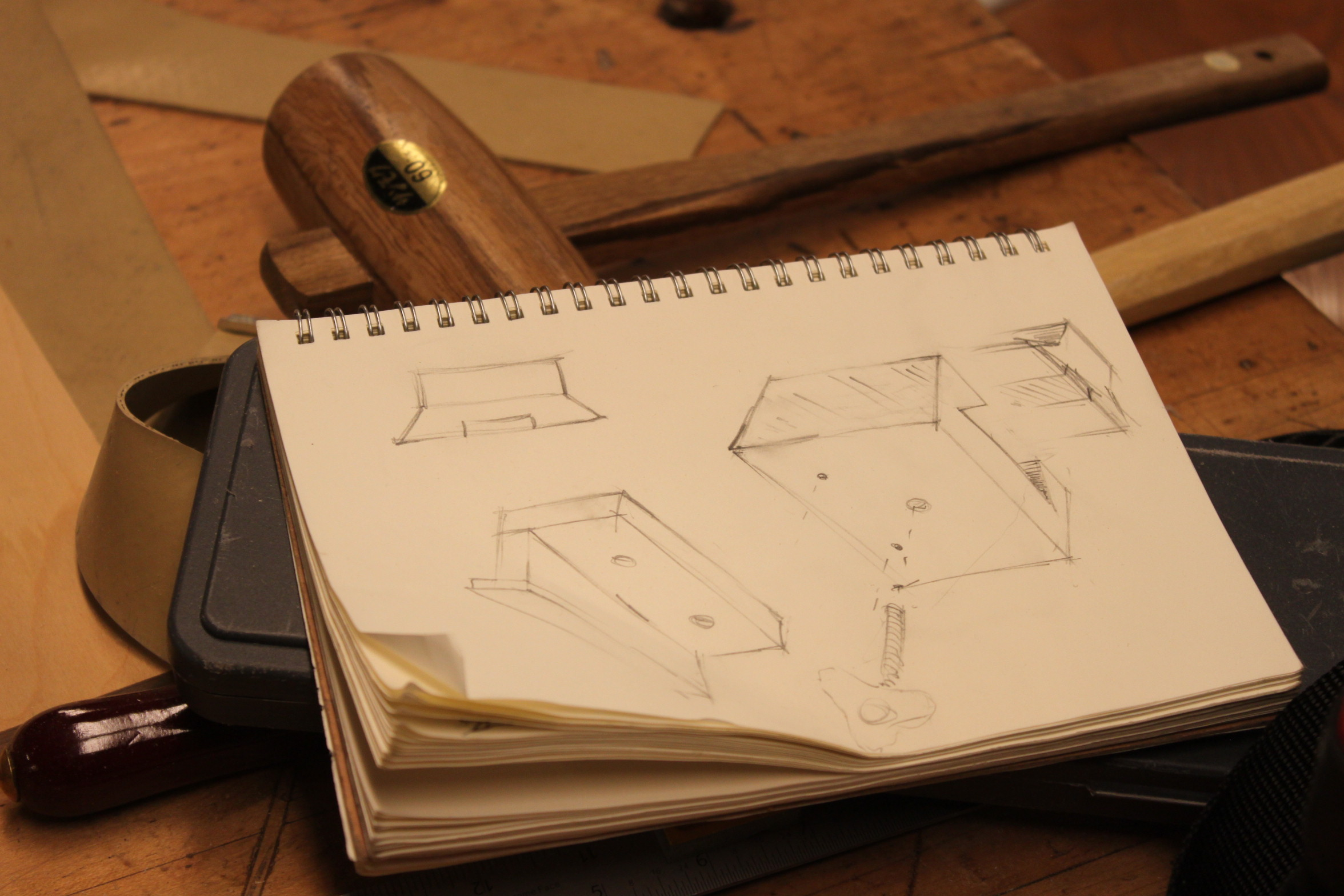 Laying open on a workbench sits Trevor Rogers' carpentry sketchbook. Photo taken on Nov. 13, 2017.