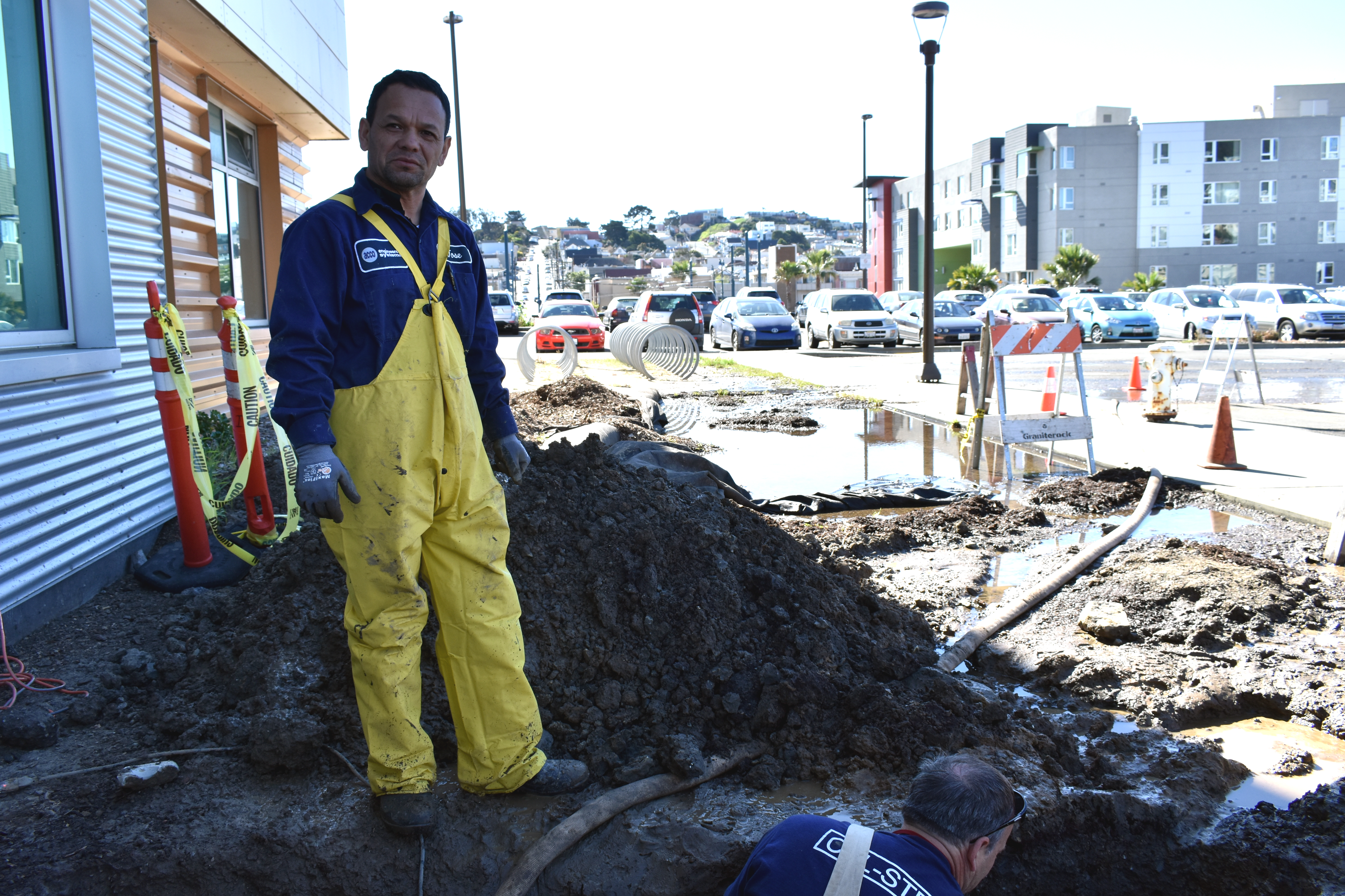 (L-R) ACC Engineering Systems Plumber Jose Lopez and a man who goes by Dave The Plumber finish digging a hole to uncover the source of a water leak at the Ocean Campus Multi-Use Building (MUB) on Feb. 15, 2018. Photo by Michael Menaster/The Guardsman.
