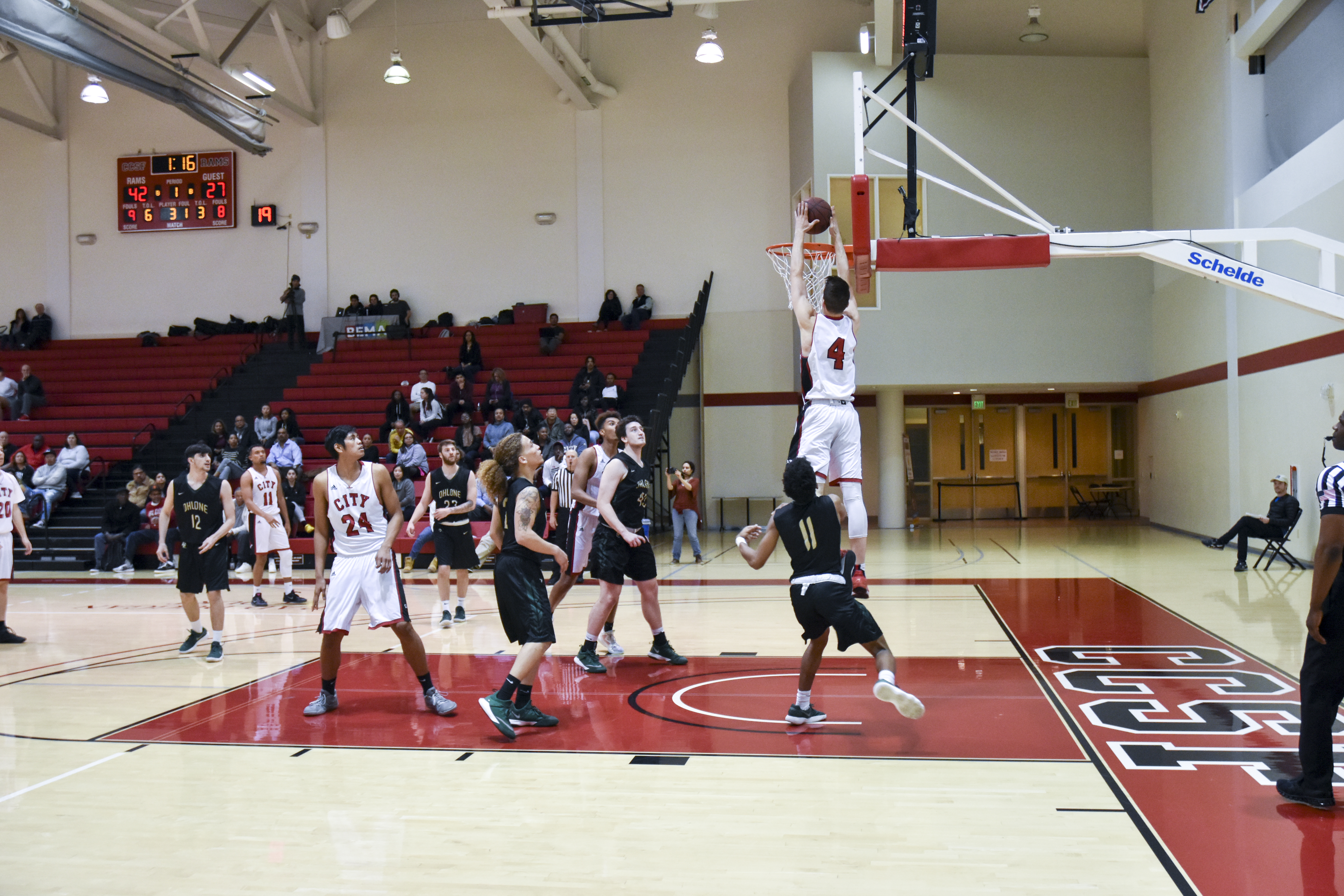 City College Ram's sophomore guard Eddy Ionescu (#4) receives lob pass from sophomore guard Eddie Stansberry (#11) for the two-hand jam against Ohlone College on Feb. 16, 2018. Photo by Michael Menaster/special to The Guardsman.
