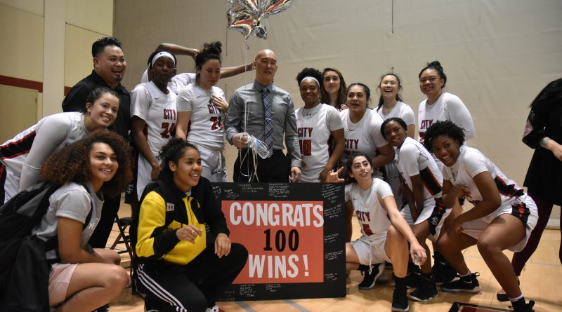 The Rams Head Coach Derek Lau (center) and team gather around to celebrate his 100th career win as City College women's basketball coach. Photo by Michael Menaster/special to The Guardsman.