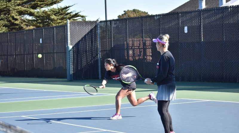 Ram's No. 1 ranked doubles players sophomore Yvonne Ng (left) and sophomore Zee Aynaci return rally against opponent Cañada College on Feb. 16, 2018. Photo by Veronica Steiner/The Guardsman.