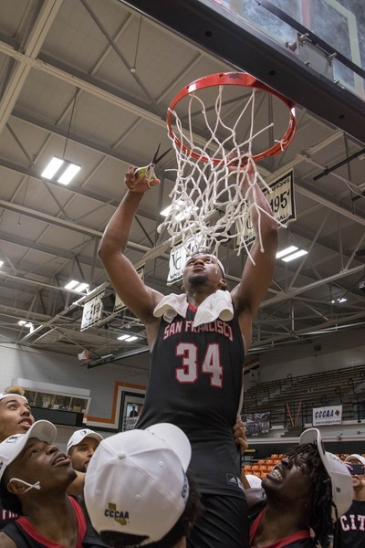After defeating San Diego City College, the Rams' sophomore guard Michael Wright (#55), forward Lewis Hayes (#34), freshman guard Niamey Harris (#3), sophomore Ben Borja (#24), and Head Coach Justin Labagh are hoisted for the ceremonial cutting of the net on March 13, 2018. Photos by Felix Cortez/Special to The Guardsman.