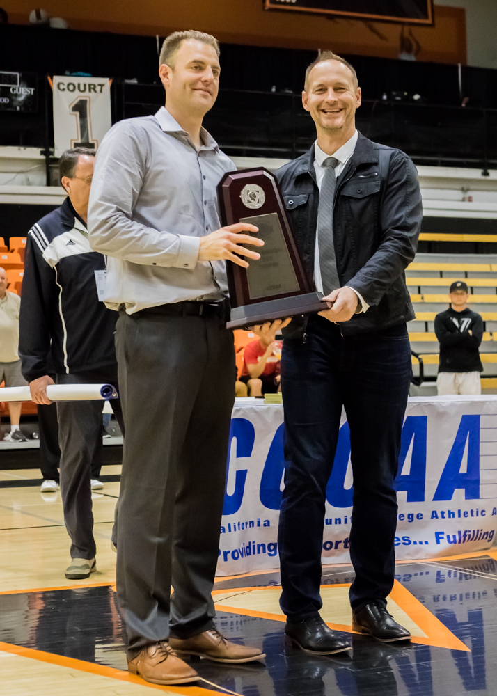 Coach Justin Labagh (left) accepts CCCAA State Title trophy from leagues president Steve Ball after beating San Diego City College in Ventura on March 13, 2018. Photo by Peter Wong/Special to The Guardsman.