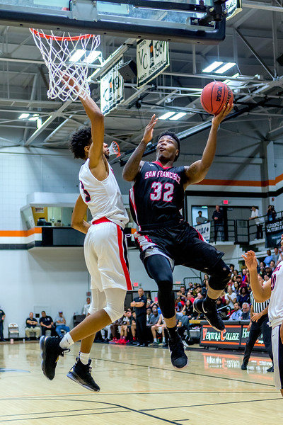 Freshman guard Dexter Hood (#32) elevates for the contested layup on March 13, 2018 during the CCCAA State Title game in Ventura. Photo by Peter Wong/Special to The Guardsman.