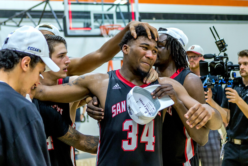 Sophomore forward Lewis Hayes (#34) is cheered on by teammates after receiving the CCCAA tournament MVP trophy.  Photo by Peter Wong/Special to The Guardsman.