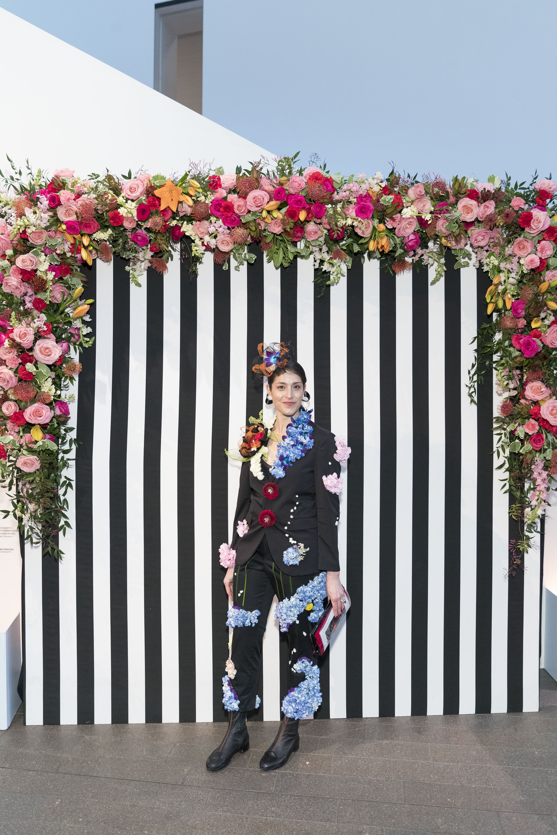 Shari Wilk created this floral pantsuit modeled by Betsey Herczeg-Konecney at the Bouquets to Art Gala on March 12, 2018 at de Young Museum in San Francisco, CA. Photo by Drew Altizer/Courtesy of the Fine Arts Museum of San Francisco.