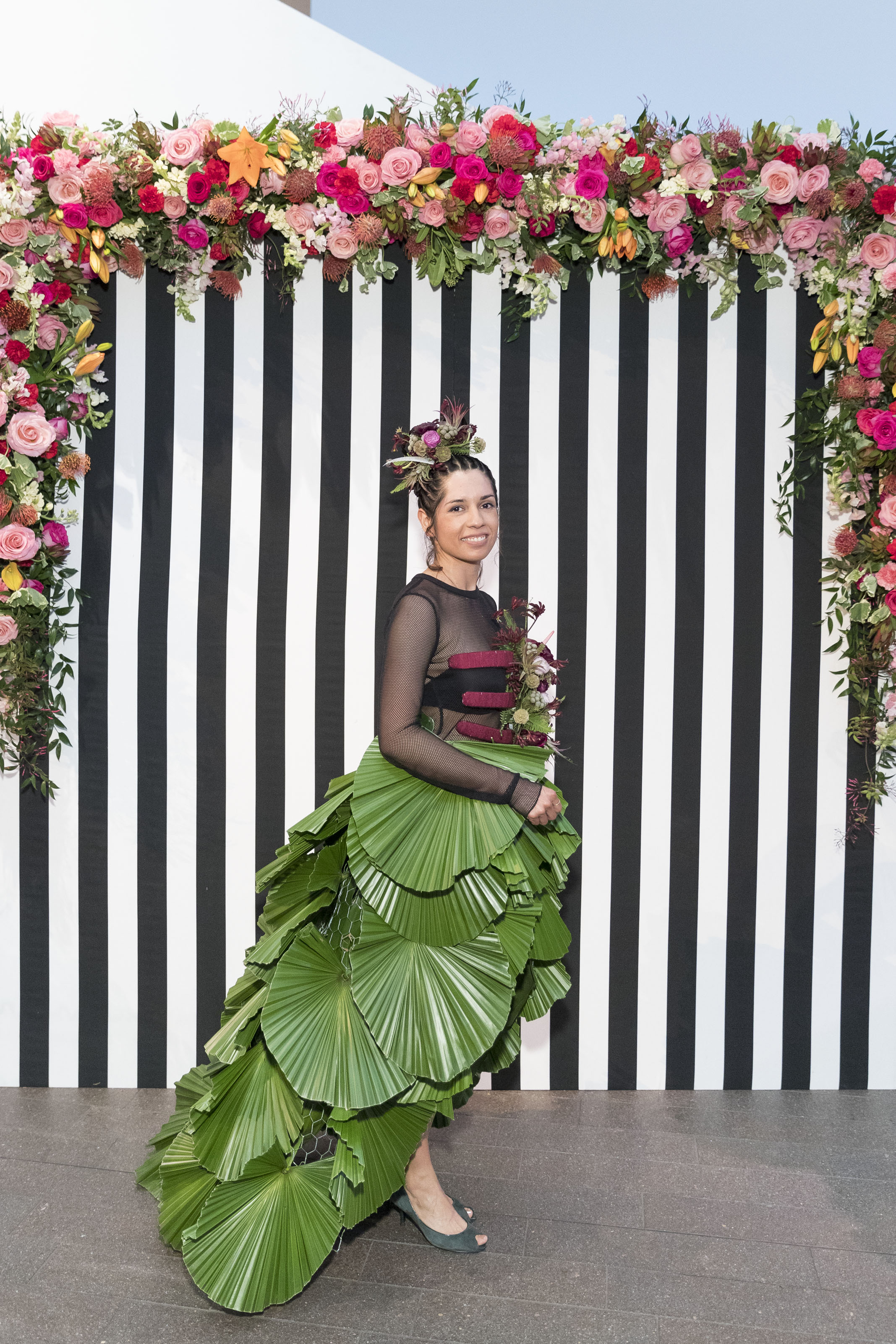 Liberty Velez models Rosa Mendoza's dress with a long train of pal leaves on March 12, 2018. Photo by Drew Altizer/Courtesy of the Fine Arts Museums of San Francisco.