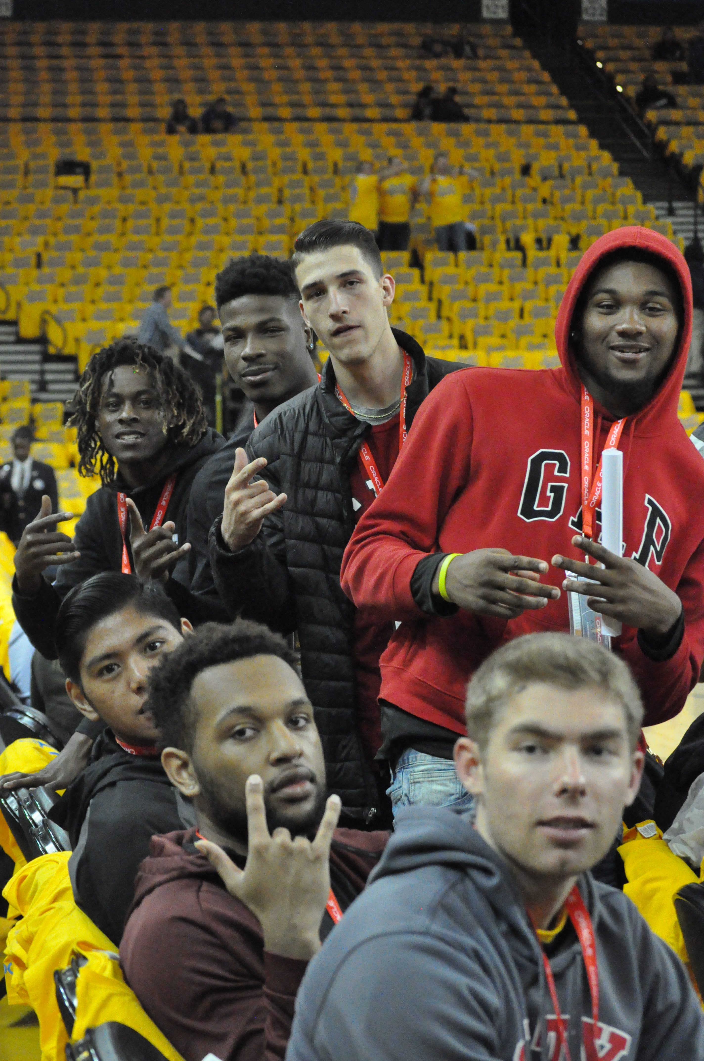 Rams players Curtis Witt, front to back, Austin Harris, Ben Borja, Lewis Hayes, Eddy Ionescu, Dexter Hood, and Terrell Brown sitting court-side during warmups at the Warriors vs Spurs Game 2 NBA playoff on April 16, 2018.  Photo by Peter J. Suter/The Guardsman.