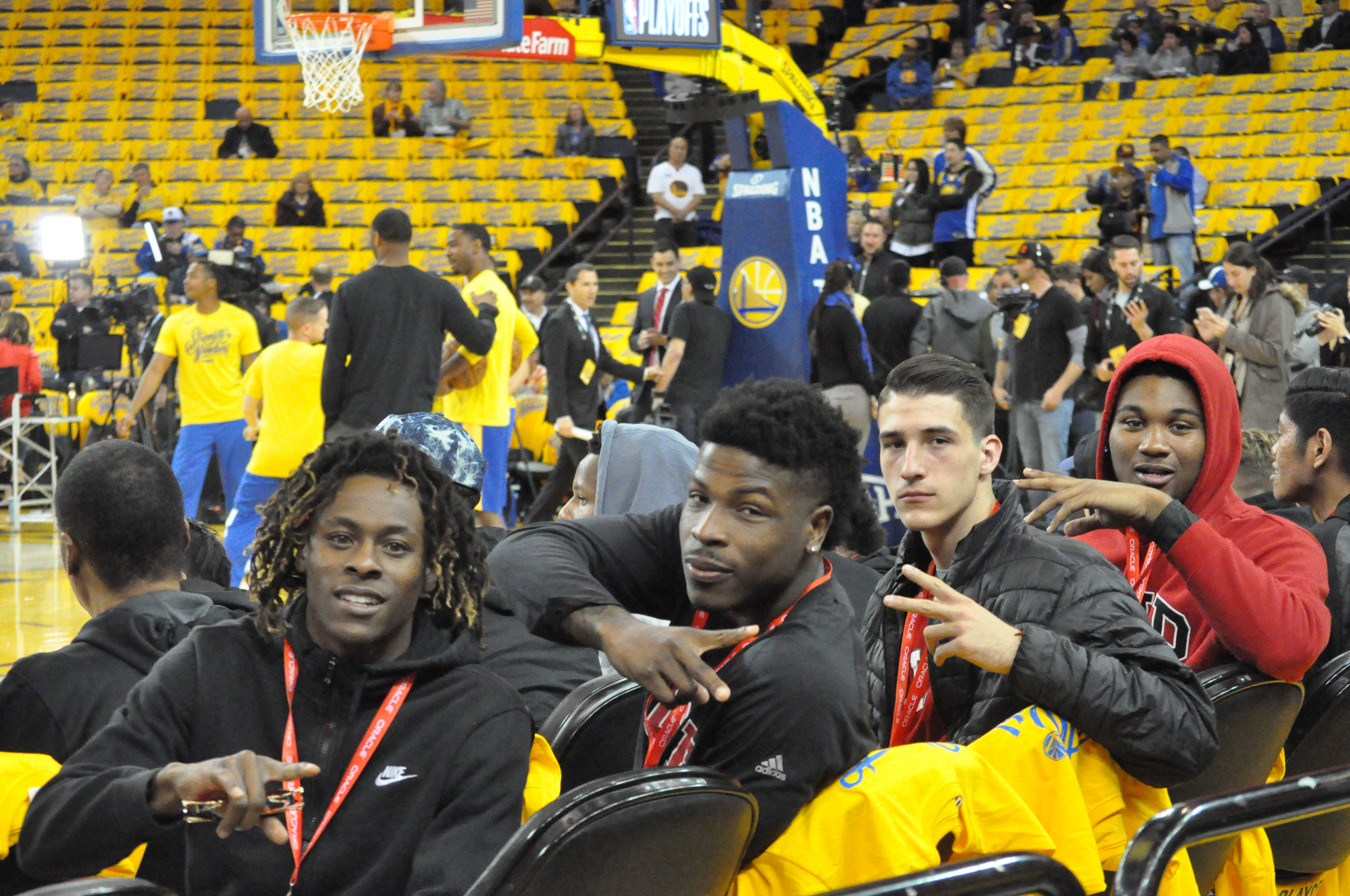 Rams men's basketball players Terrell Brown, left to right, Dexter Hood, Eddy Ionesco, and Lewis Hayes sit court side during Warriors warm-up session on April 16, 2018. Photo by Peter J. Suter/The Guardsman.