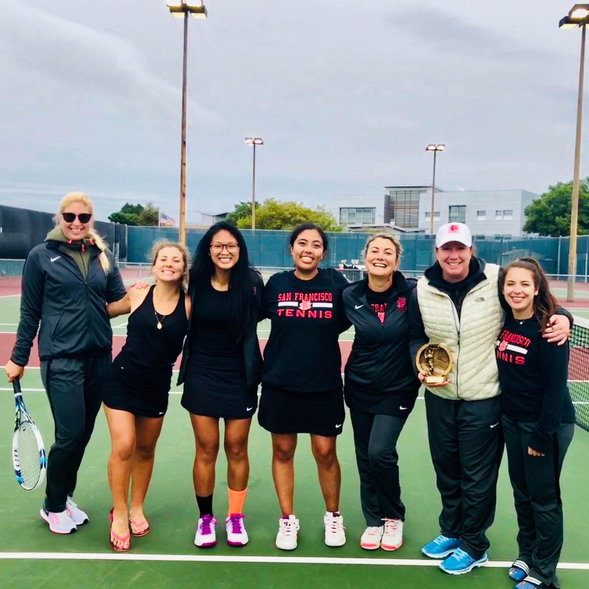 (L-R) Caroline Olander, Claudia Houdre, Yvonne Ng, Abigail Campos, Zee Aynaci, Coach Hickey, Aliza Sandberg after advancing to the Nor-Cal Conference Tournament and receiving Conference Co-Coach of the year. Photo courtesy of CCSF Athletics Department.