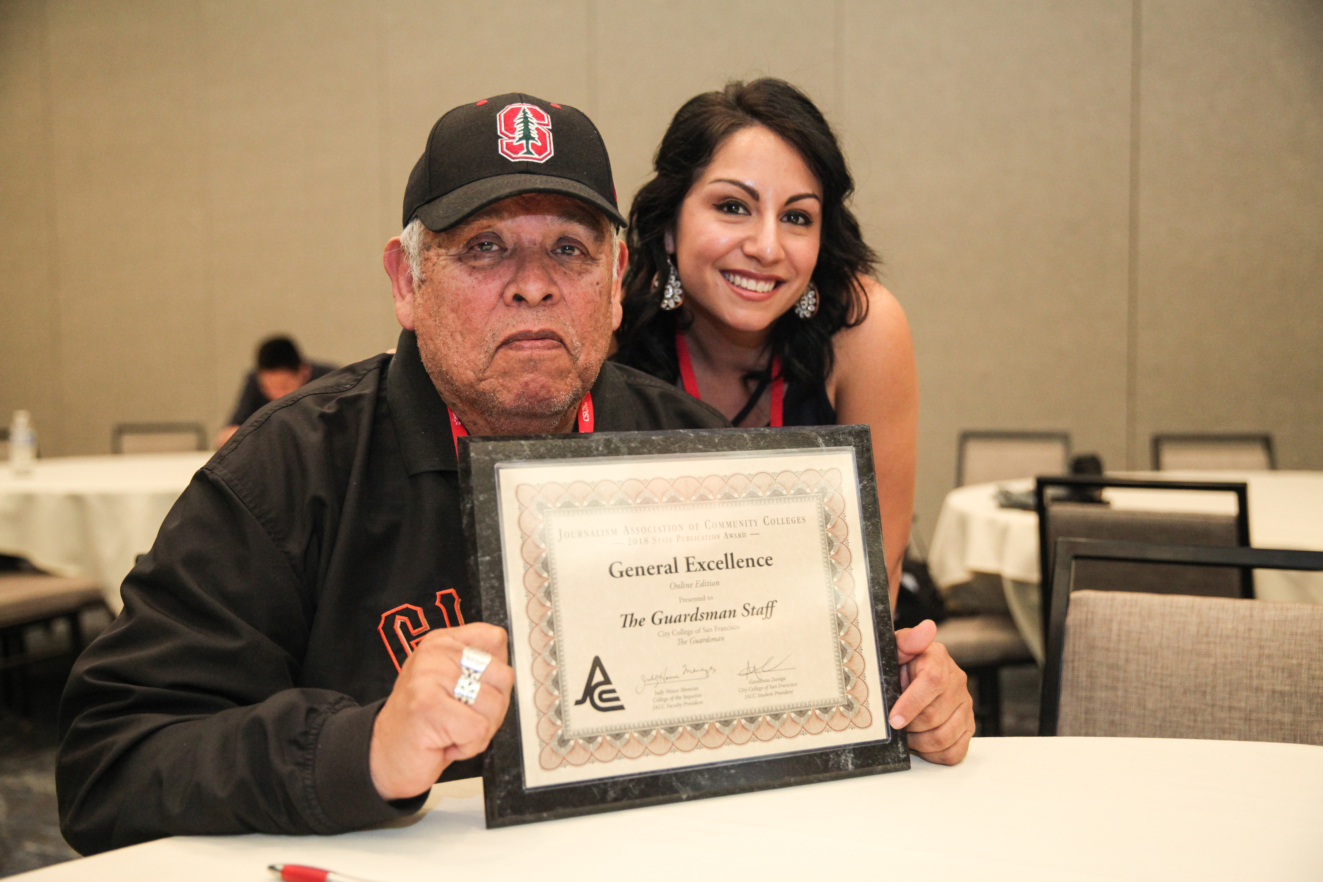Juan Gonzales and JACC president Gardenia Zuniga-Haro smile with one of the 15 earned awards at Journalism Association of Community College on March ##, 2018. Photo by Ekevara Kitpowsong/The Guardsman.