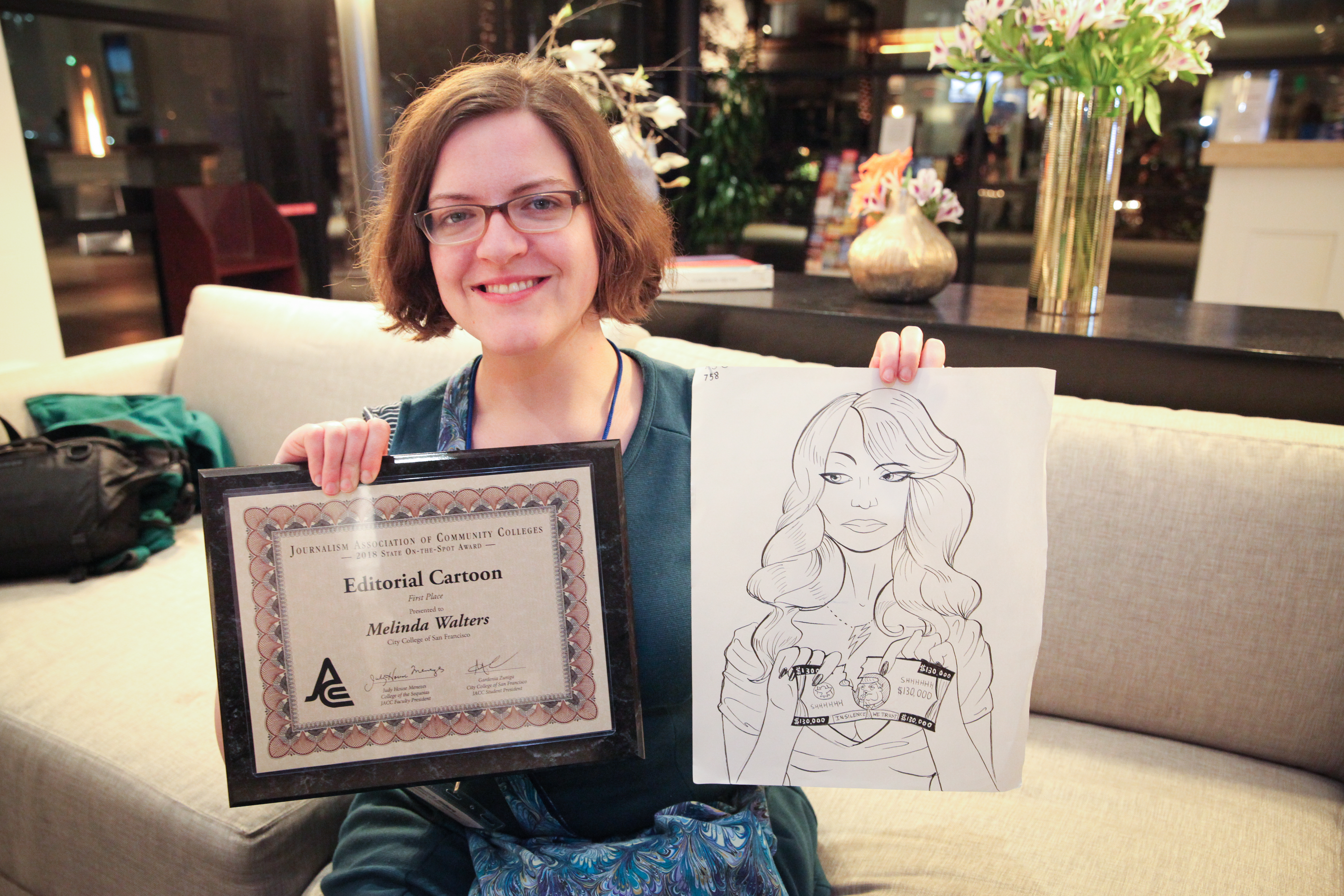 City College of San Francisco student Melinda Walters holds the First Place award she received from On-the-Spot Editorial Cartoon contest during the 2018 JACC State Convention held at Burbank Marriott Convention Center on Saturday, March 24, 2018 in Burbank, Calif. Photo by Ekevara Kitpowsong/The Guardsman.