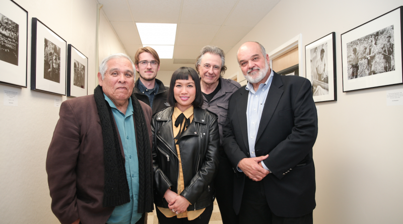 """Journalism department chair Juan Gonzales, curator James Fanucchi, curator Ekevara Kitpowsong, former Reuters Photo Bureau Chief Lou Dematteis, and Pulitzer Prize-winning photojournalists Kim Komenich at the opening reception of """"In the Line of Fire"""" on Friday, April 13, 2018. Photo by David Horowitz/Special to The Guardsman."""