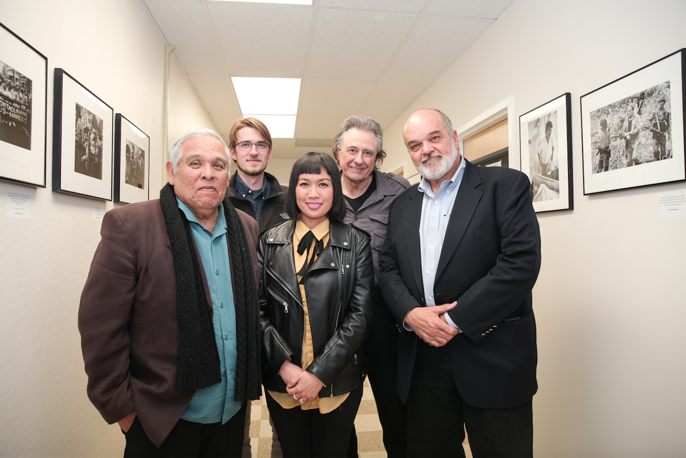 "Journalism department chair Juan Gonzales, curator James Fanucchi, curator Ekevara Kitpowsong, former Reuters Photo Bureau Chief Lou Dematteis, and Pulitzer Prize-winning photojournalists Kim Komenich at the opening reception of ""In the Line of Fire"" on Friday, April 13, 2018. Photo by David Horowitz/Special to The Guardsman."