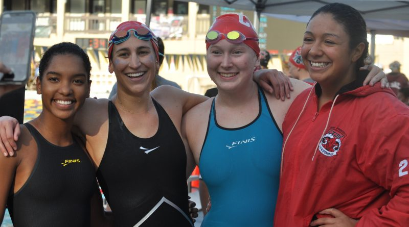 Carla Sakia Hovde, left to right, Bianca Taylor, Keelin Alspaugh, and Julia Lane after competing in the 800 Free Relay at De Anza on May 4, 2018. Photo by Peter J. Suter/The Guardsman.