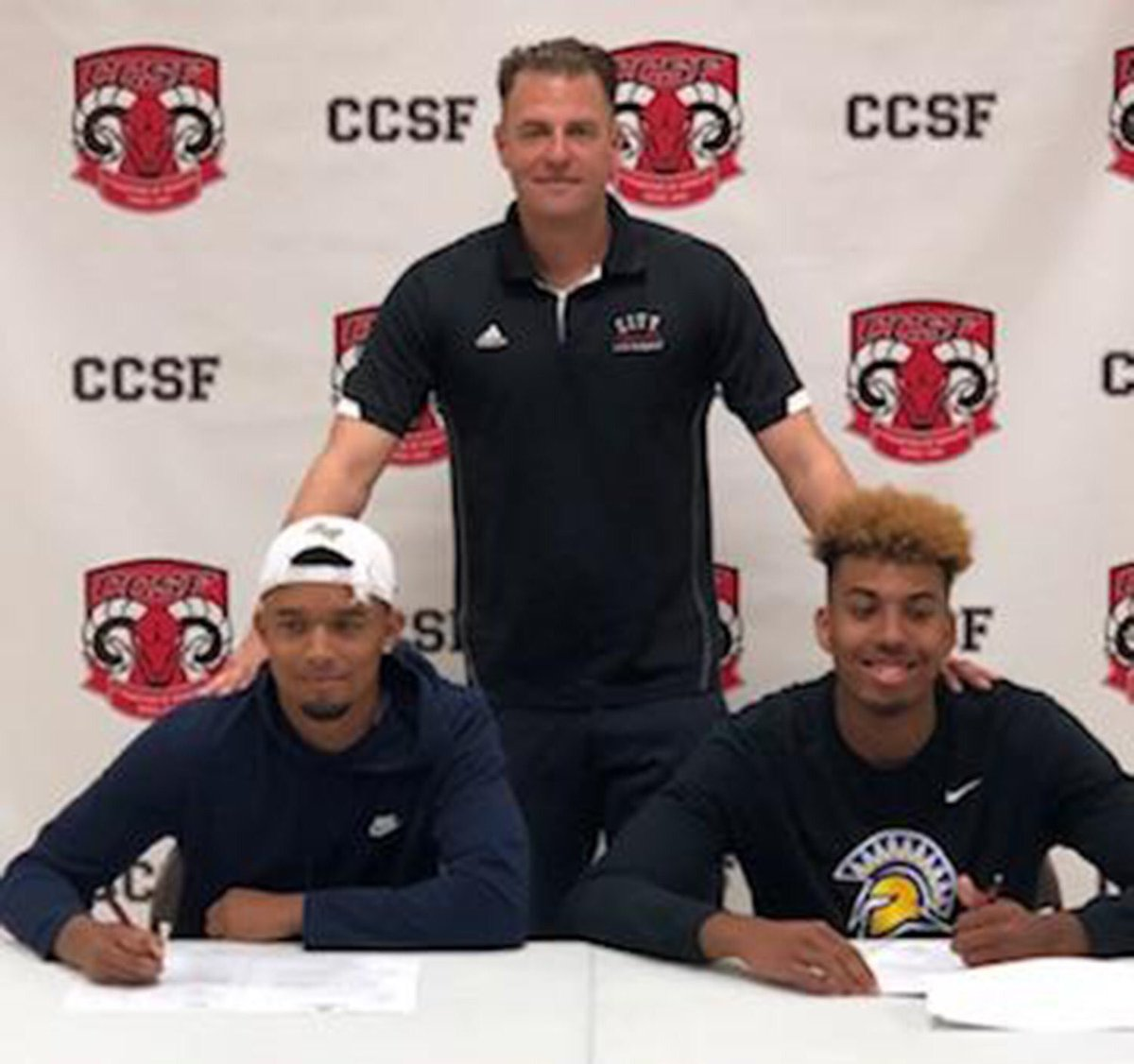 Eddie Stansberry, left to right, Coach Labagh, and Michael Steadman sign to four-year universities on April 16, 2018. Photo courtesy of CCSF Athletic Department.