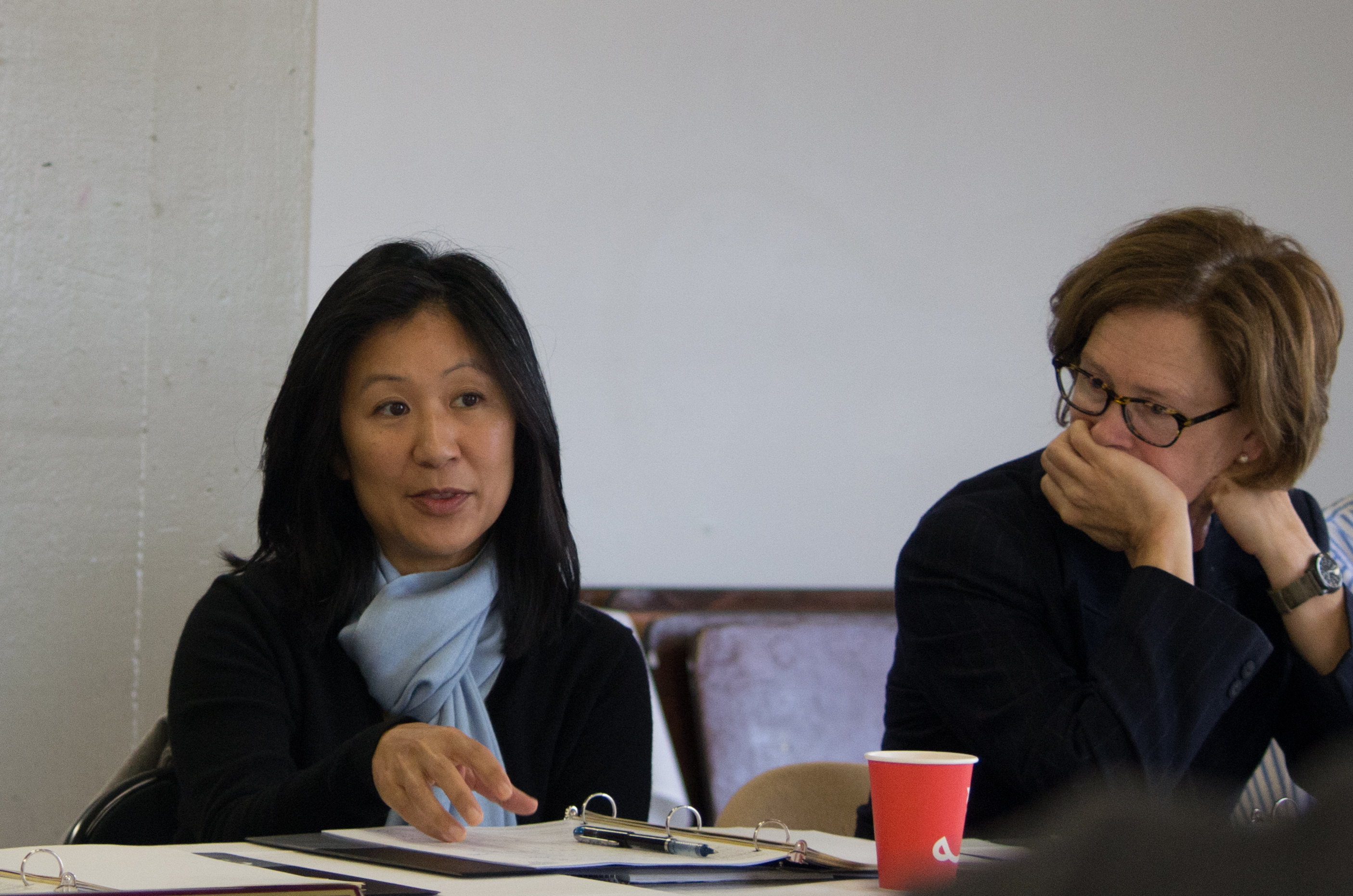 City College Trustee Ivy Lee, left, engages her colleagues in discussion at a board retreat as Trustee Thea Selby, right, listens in on Aug. 10 at the college's Fort Mason Center. (David Mamaril Horowitz / The Guardsman)