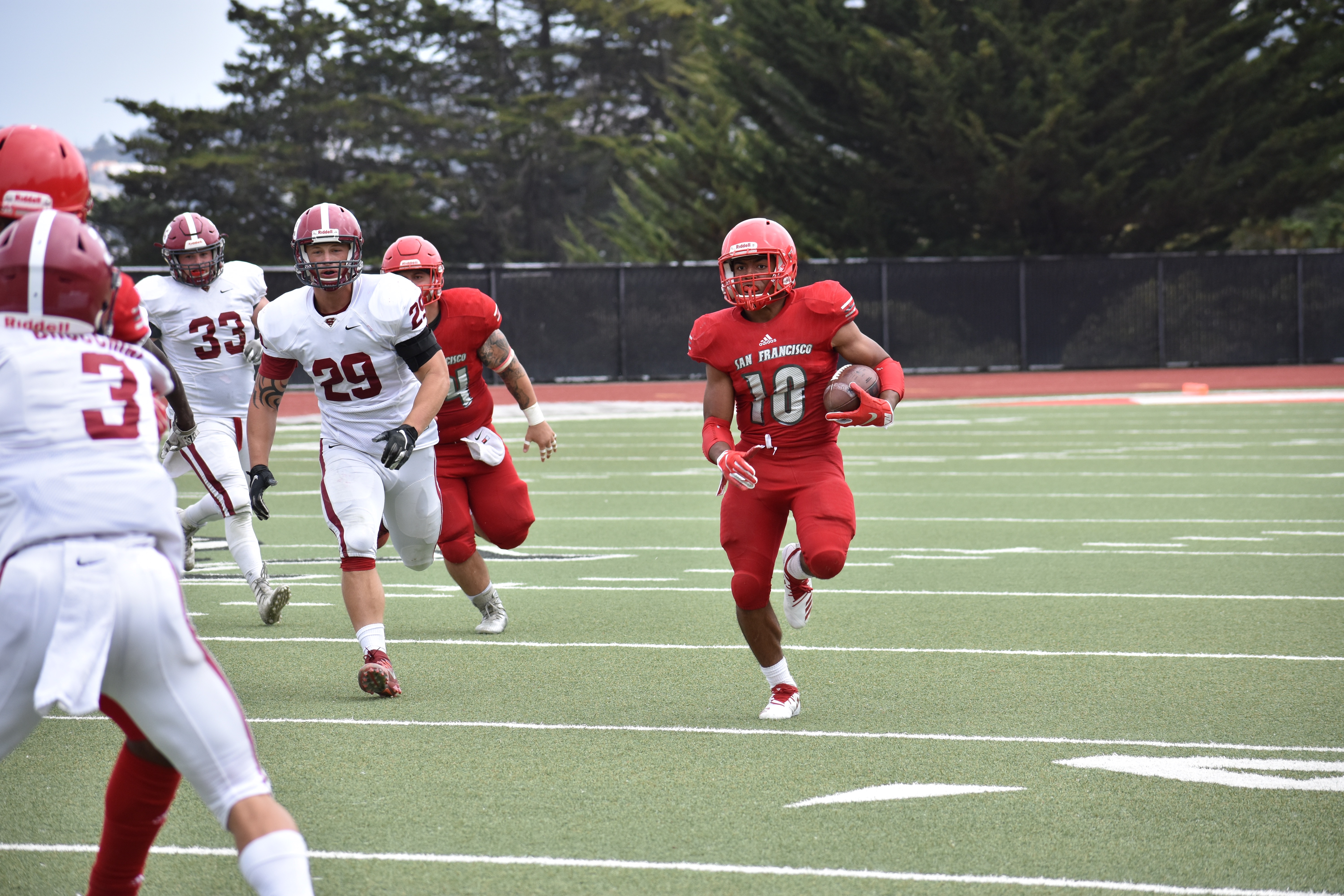City College's DeShawn Collins (#10) rushed for a first down September 1, 2018 Photo by Veronica Steiner/ The Guardsman