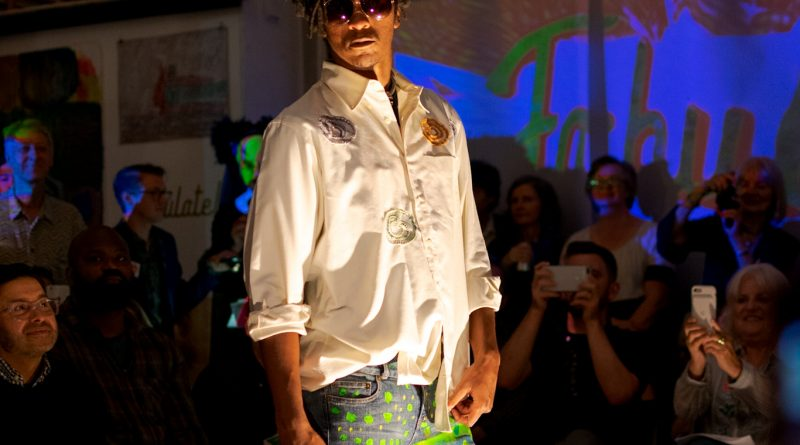 Model poses at the end of the catwalk to showoff the intricate stitches on the Oxford shirt by Ethel Revita and custom-made pants done by Makeya Kaiser. Thursday, Sept. 20, 2018. Photo by Cliff Fernandes/The Guardsman