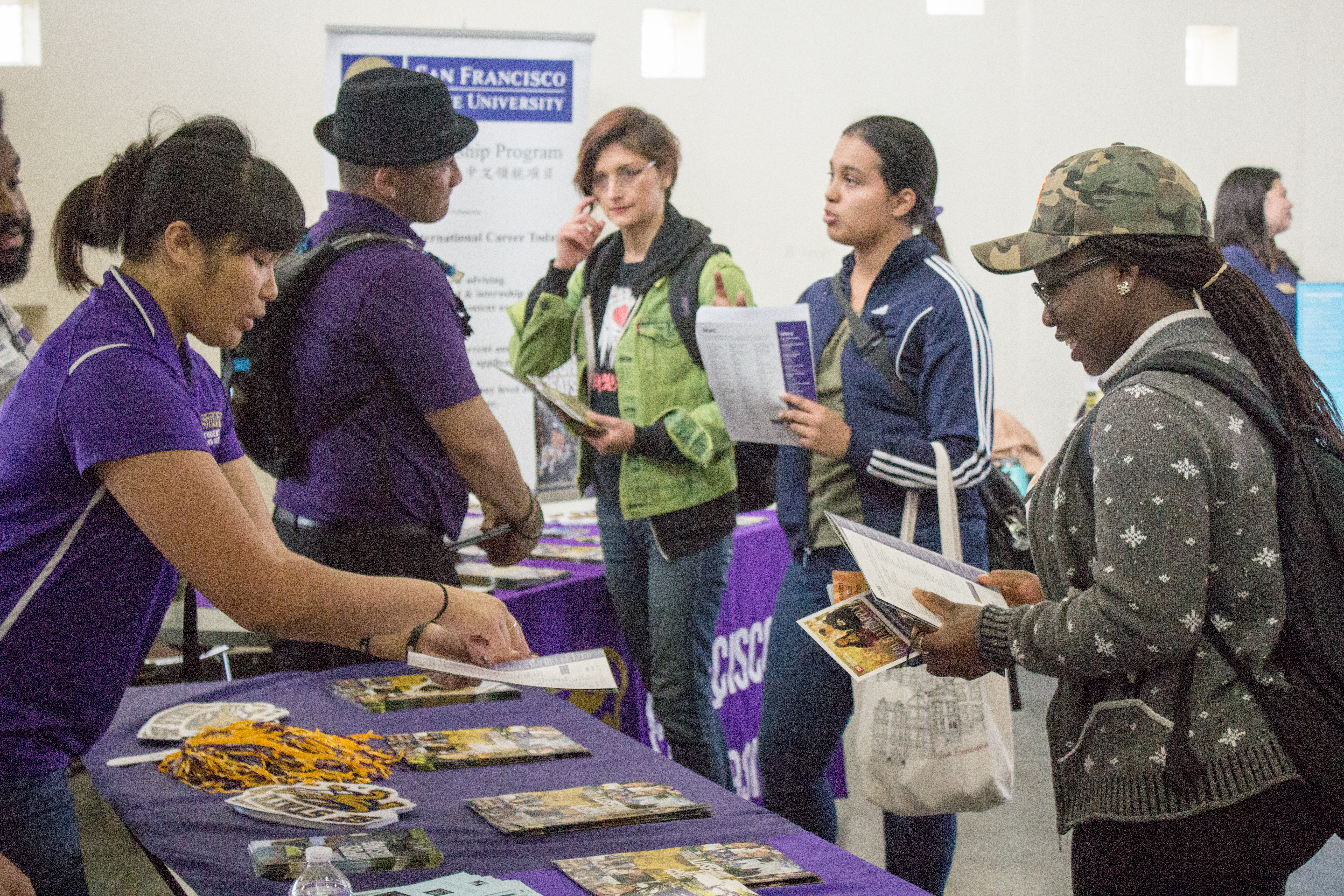 San Francisco State  University Outreach Specialist Tabitha Hurdle, left, provides school information for City College student Stellamaris Nwihim, right. Photo by Peter J Suter/The Guardsman
