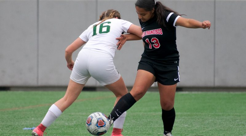 Daniela Tremillo #13, wins the ball and shrugs off the challenge at the half way line. Friday, Sept. 21, 2018. Photo by Cliff Fernandes/The Guardsman